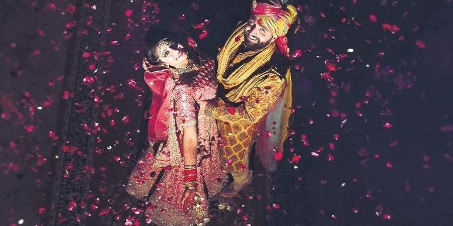 Photographer Faizan Patel's(left) wedding compositions stand out