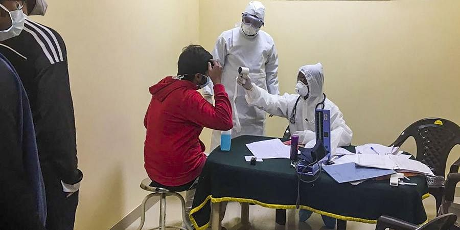 Indian nationals who were airlifted from coronavirus-hit Hubei province of China's Wuhan undergo tests inside a quarantine facility set by up ITBP at Chhawla area of New Delhi