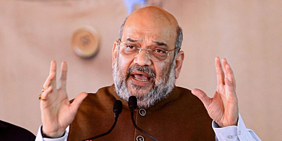 Amit Shah addresses an election rally in support of BJP candidate Satyendra Nath Tiwary ahead of Jharkhand Assembly elections in Garhwa district Thursday Nov. 28 2019.