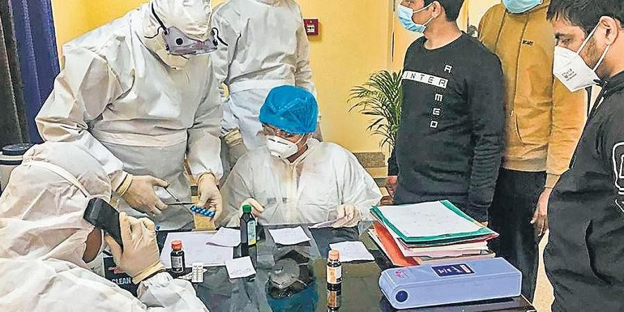 Indian nationals who were airlifted from coronavirus-hit Hubei, China, undergo tests inside a quarantine facility