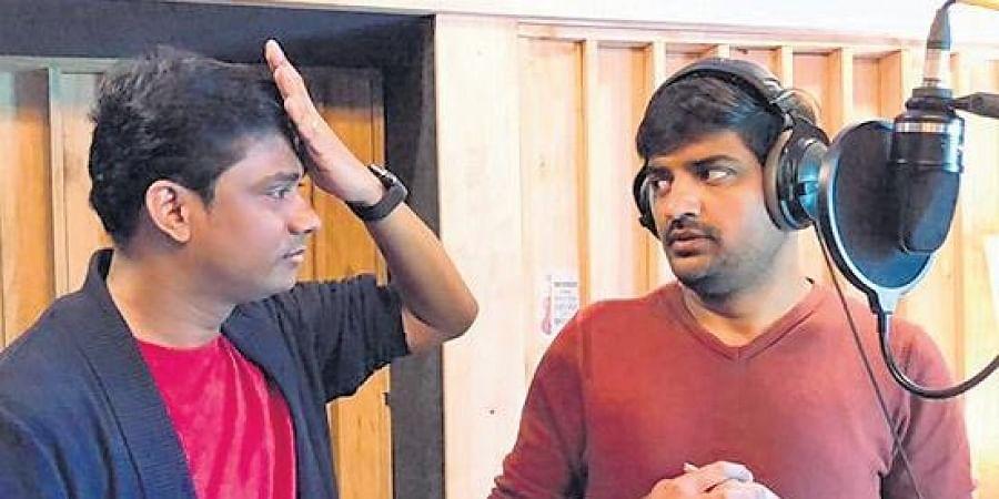 Music director Sam CS with Sathish.