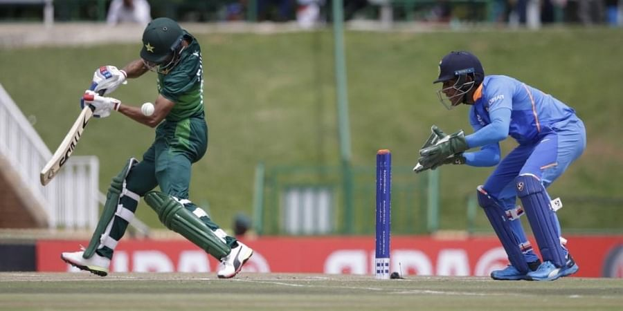 Pakistan's Fahad Munir (L) plays a shot as India's Dhruv Jurel (R) looks on during the Semi-Final of the ICC Under-19 Cricket World Cup. (Photo   AFP)