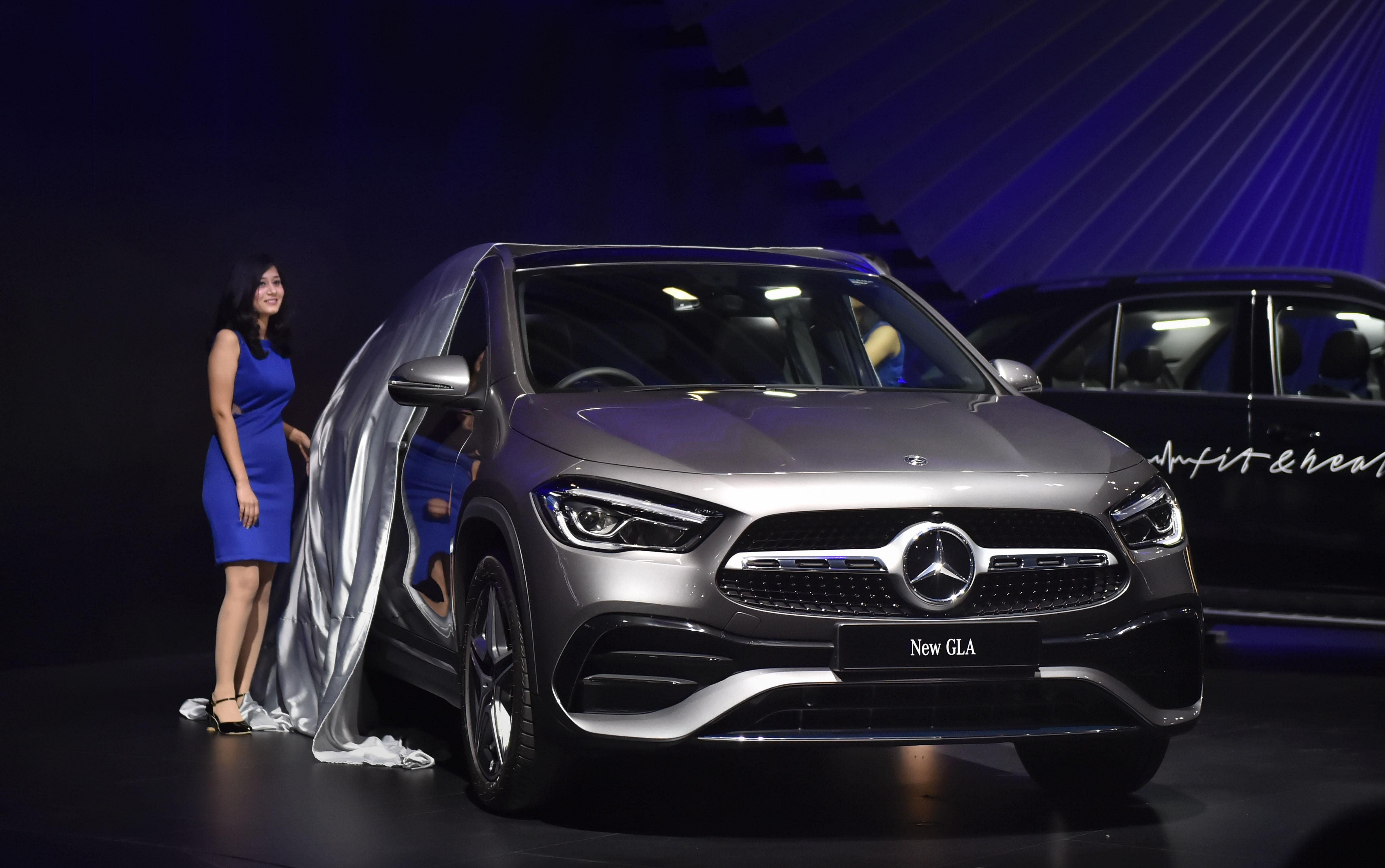 A model unveils Mercedes Benz GLA at the Auto Expo in Greater Noida