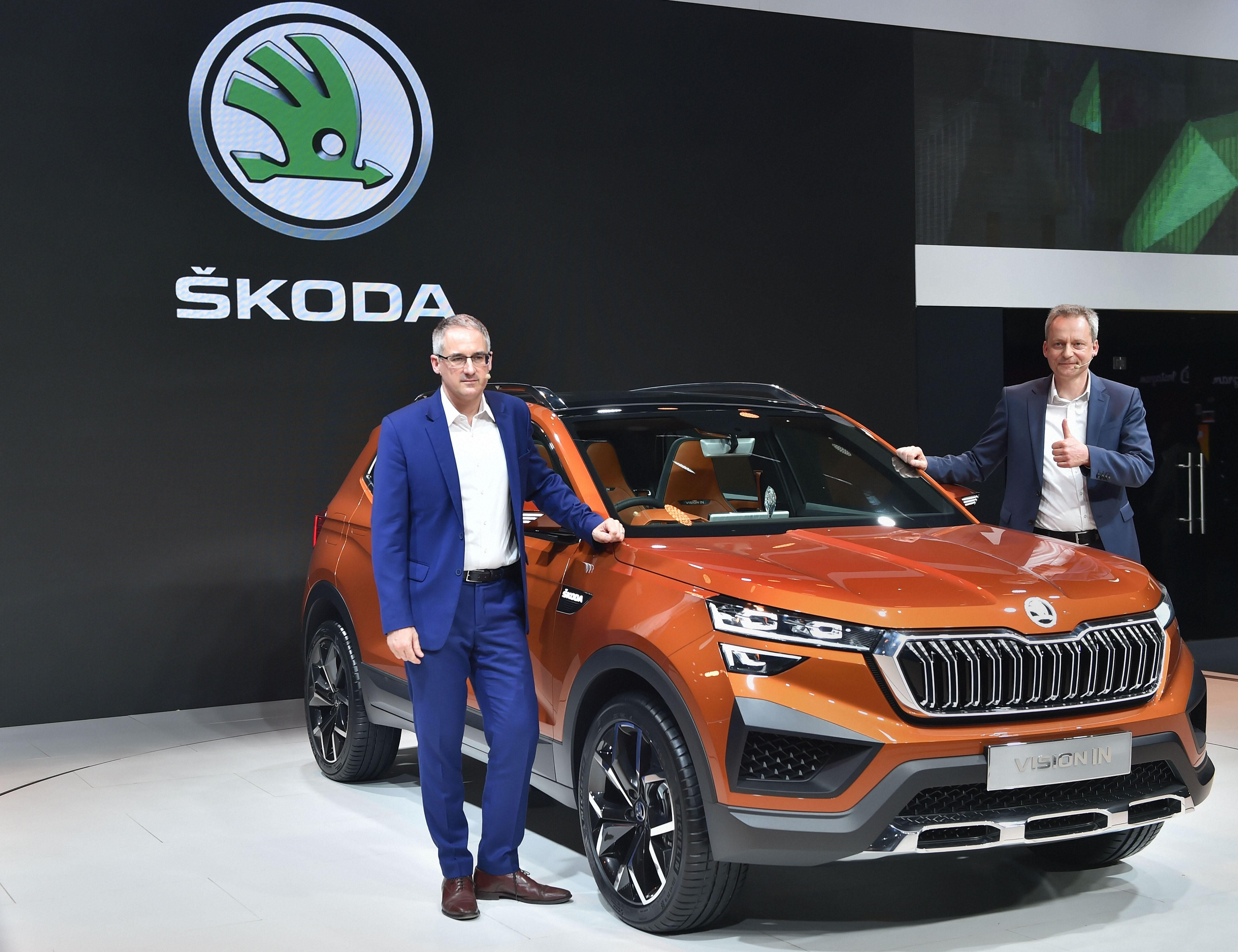 Skoda India Head (Sales & Marketing) Zac Hollis (L) with the newly-unveiled Skoda Vision IN, during the Auto Expo 2020 in Greater Noida