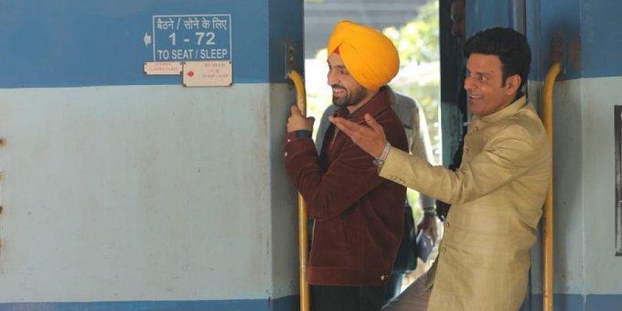 Manoj Bajpayee (R) and Diljit Dosanjh (L) in a still from their upcoming movie 'Suraj Pe Mangal Bhari'.