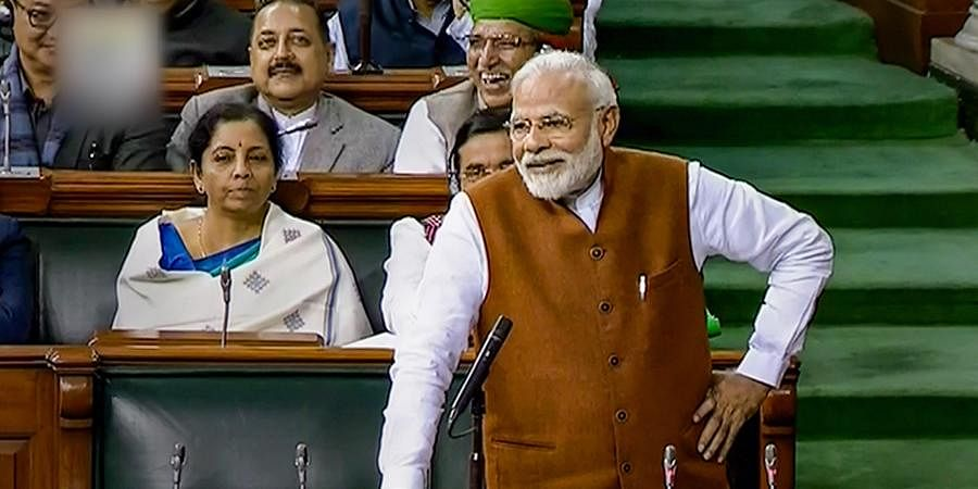 Prime Minister Narendra Modi speaks in the Lok Sabha during the ongoing Budget Session of Parliament in New Delhi Thursday.
