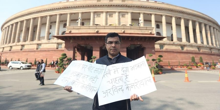 BJP MP Parvesh Verma protest against at Aam Admi Party at Parliament House in New Delhi on Wednesday. (Photo | Shekhar Yadav/EPS)