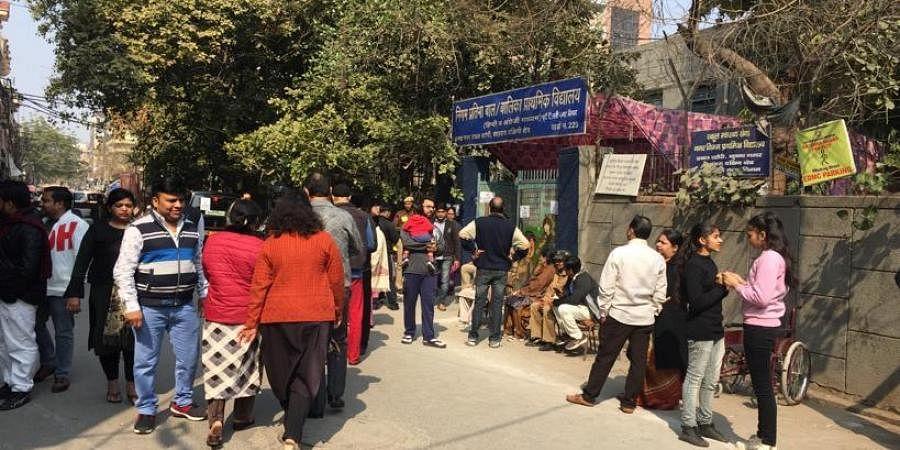 Voting in full swing at Krishna Nagar in New Delhi on Saturday.