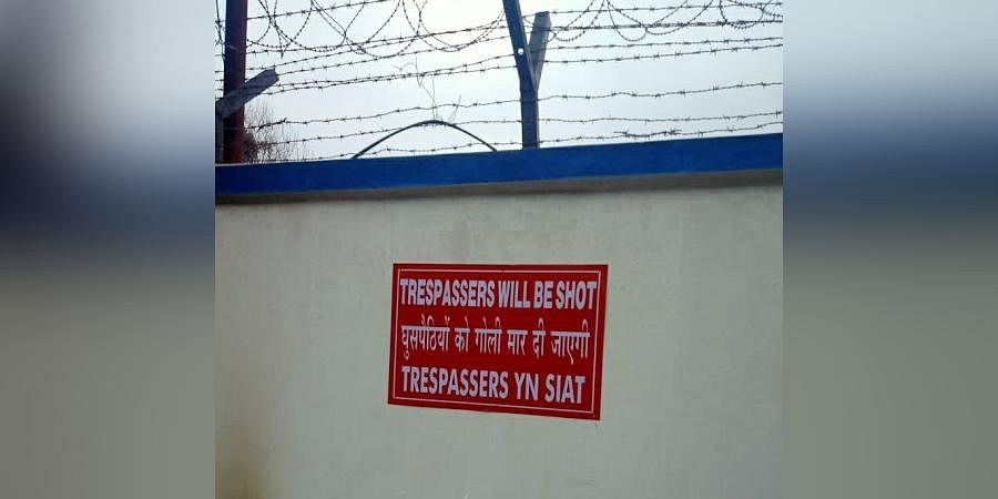 """Poster saying""""trespassers will be shot"""" put up by the Indian Air Force (IAF) on the outer wall of its installation in Shillong"""