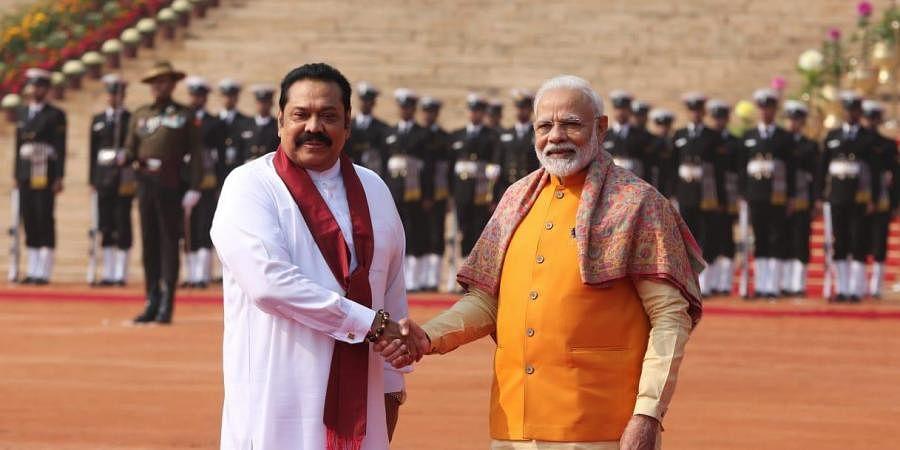 Prime Minister Narendra Modi and his Sri Lankan counterpart Mahinda Rajapaksa.