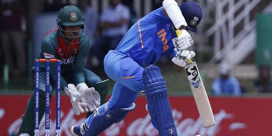 India's Yashasvi Jaiswal (R) plays a shot as Bangladesh's captain Akbar Ali (L) looks on during the ICC Under-19 World Cup cricket finals. (Photo | AFP)