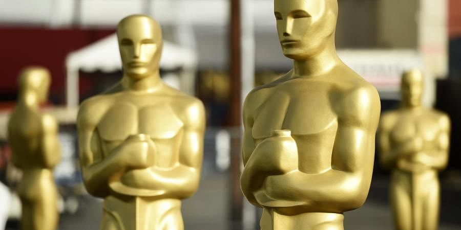 Oscar statues stand off of Hollywood Boulevard in preparation for Sunday's 92nd Academy Awards at the Dolby Theatre. (Photo | AP)