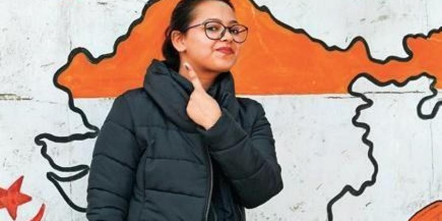 First-time voters show their fingers marked with indelible ink after casting vote during the State Assembly elections at polling stations on Saturday.
