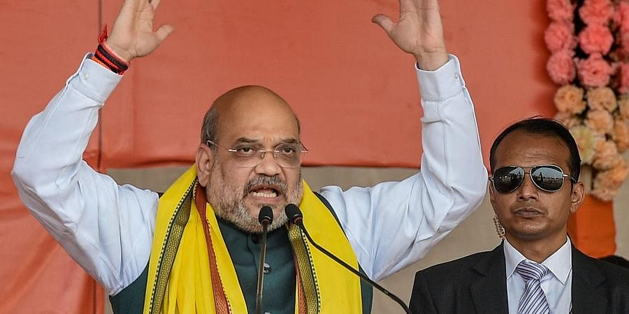 Union Home Minister Amit Shah addresses during a rally at Shaheed Minar Ground in Kolkata Sunday