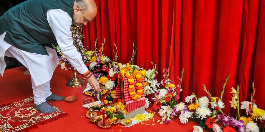 Union Home Minister Amit Shah offers prayers during the inauguration of a new building of the National Security Guards at Rajarhut on the outskirts of Kolkata Sunday.