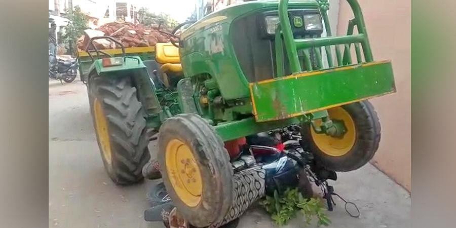 The tractor on a bike it mowed down at Chaitanyapuri