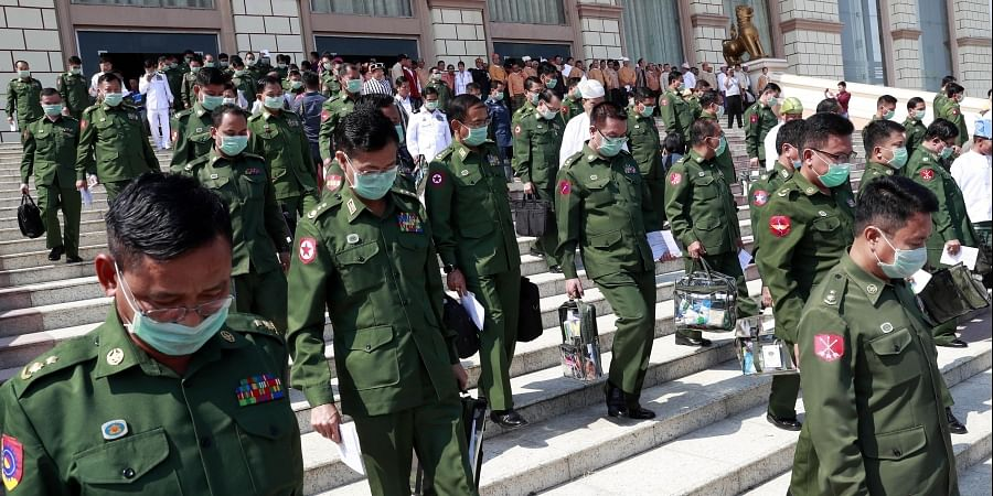 Military representatives leave after a regular session of the Union Parliament in Naypyitaw, Myanmar, Tuesday, March. 10, 2020.