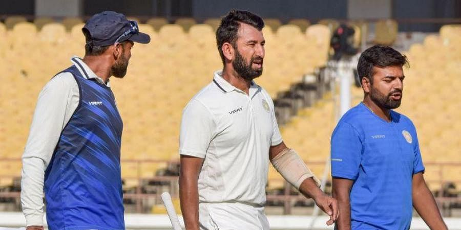 Cheteshwar Pujara took medical help twice during his brief stay before retiring ill on Day 1 of the Ranji Trophy final at SCA Stadium in Rajkot on Monday | PTi