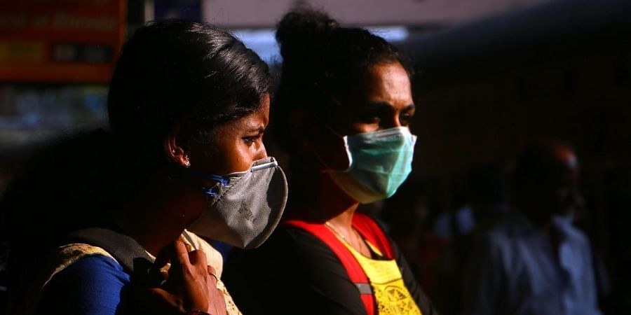 In the wake of the covid19 outbreak, travellers take precautionary measures such as protective masks while travelling.