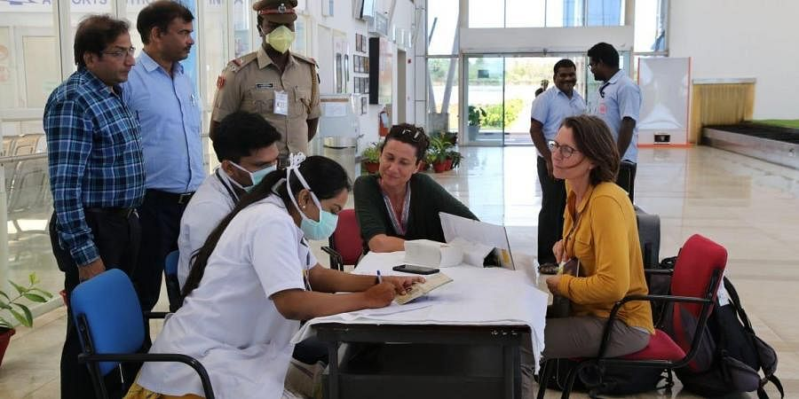 Doctors deployed at airport giving medical counselling regarding the Corono pandemic to foreign tourists entering India.