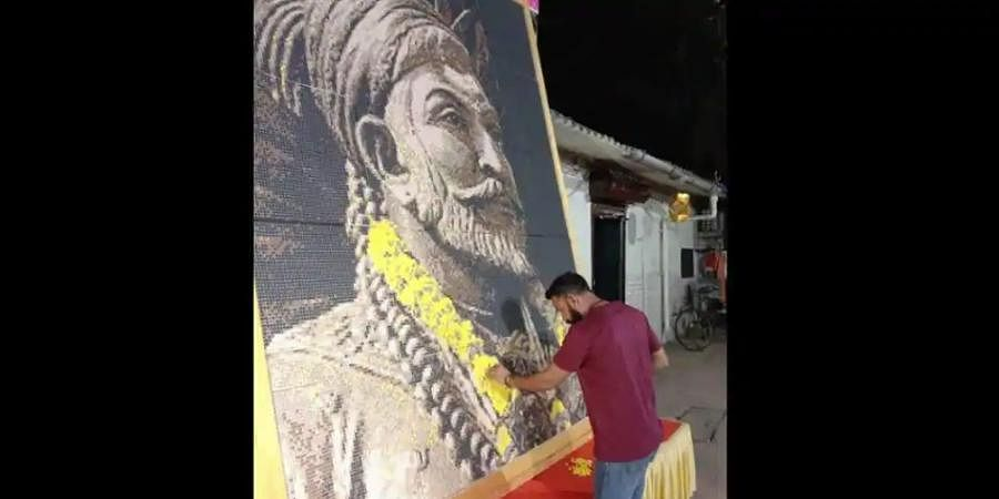 Nitin Dinesh Kamblecreated the 10X8 feet portrait in 10 days using 46,080 plastic bits of six different colours.