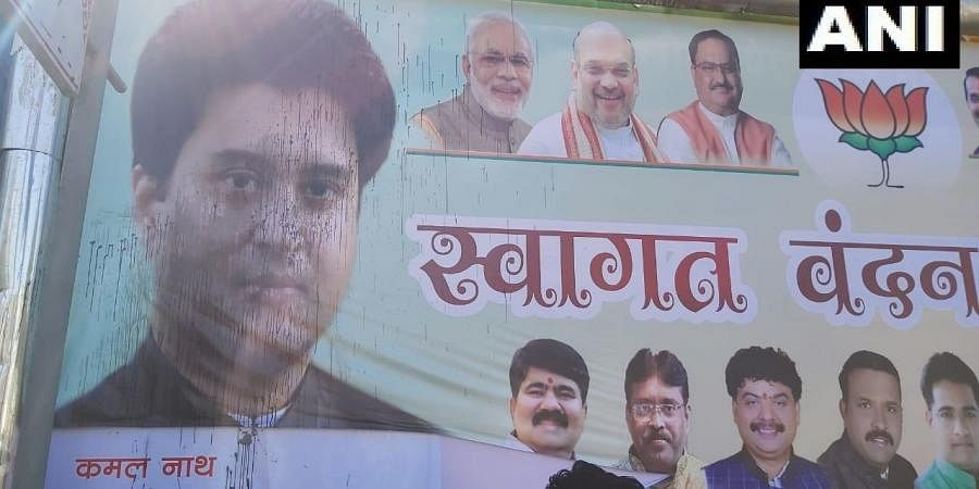 The poster featuring Jyotiraditya Scindia had ink thrown on it