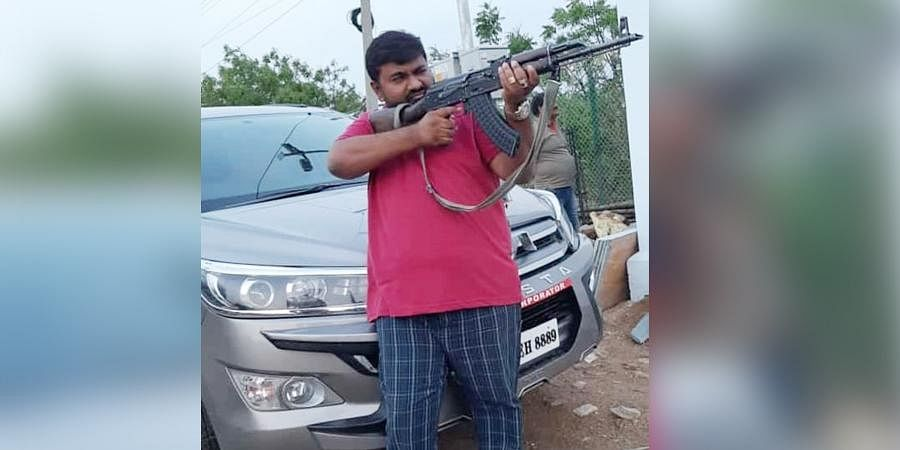 'The police personnel on duty removed the bullets in the gun and let me pose with it,' the man said