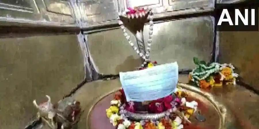 A Varanasi temple has put face masks on deities and appealed the devotees to not touch the idols.