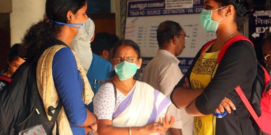 In the wake of coronavirus outbreak, people wear masks while travelling. (Photo| EPS/ TP Sooraj)