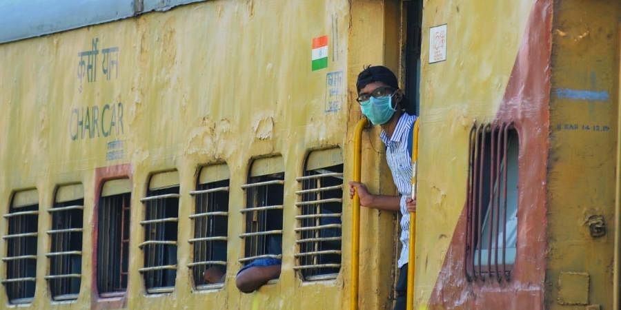 A railway passenger wearing mask owing to COVID 19 outbreak.
