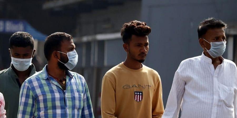 People wearing masks due to coronavirus outbreak.