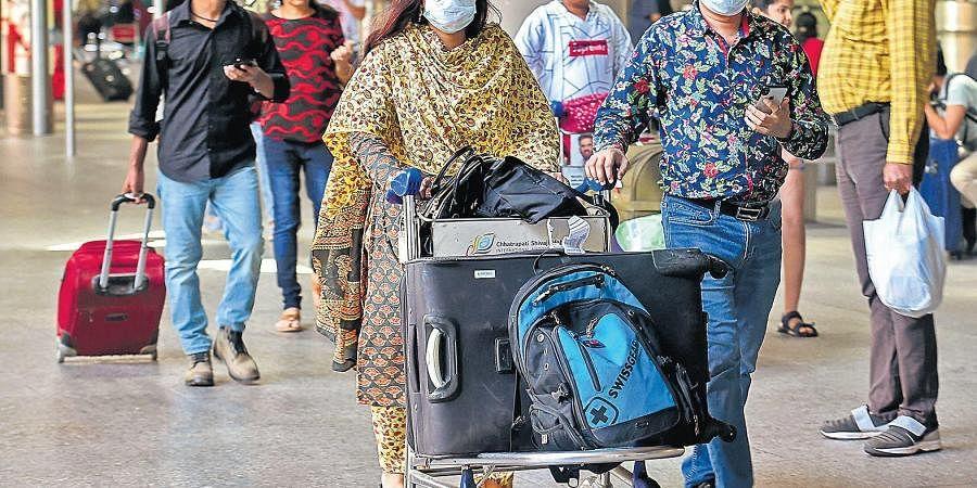Passengers wearing protective masks as a precautionary measure against the coronavirus