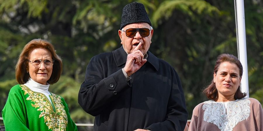 National Conference patron Farooq Abdullah with his wife Mollie Abdullah (L) and daughter Safiya Abdullah (R) speaks to media after his Public Safety Act was revoked by J-K administration at his Gupkar residence in Srinagar Friday.