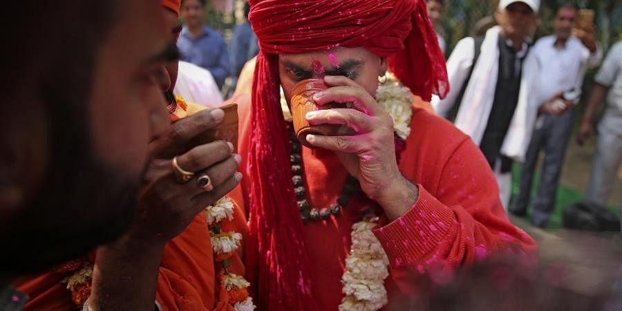 Hindu Mahasabha hosts cow urine drinking party. (Photo| AP)