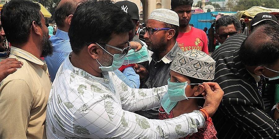 Activists distribute masks to pedestrians in Hyderabad.