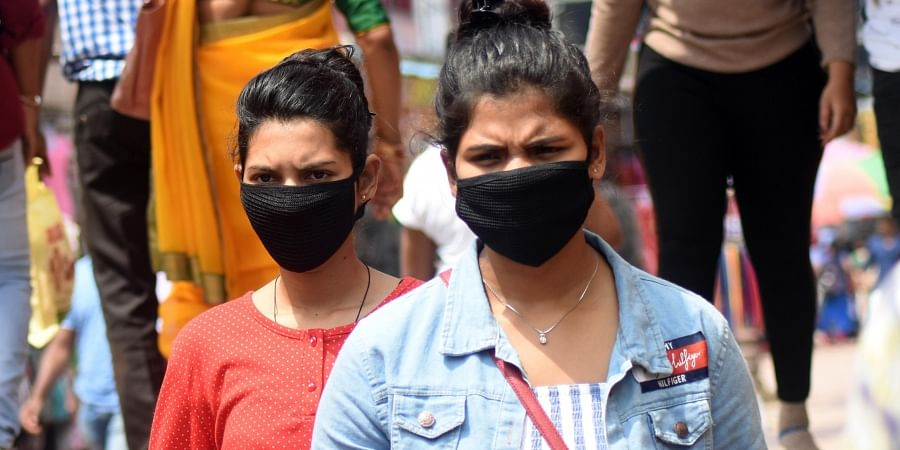 Commuters wearing face masks to guard against Coronavirus.