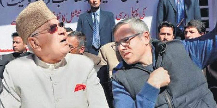 National Conference patron Farooq Abdullah and son Omar