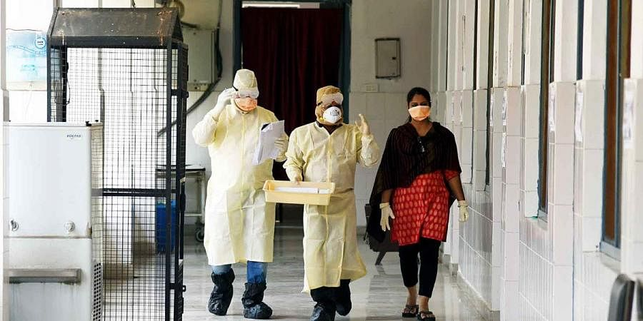 Doctors in full safety dress arrive to collect the sample from a patient at the isolation ward at Patna Medical College and Hospital