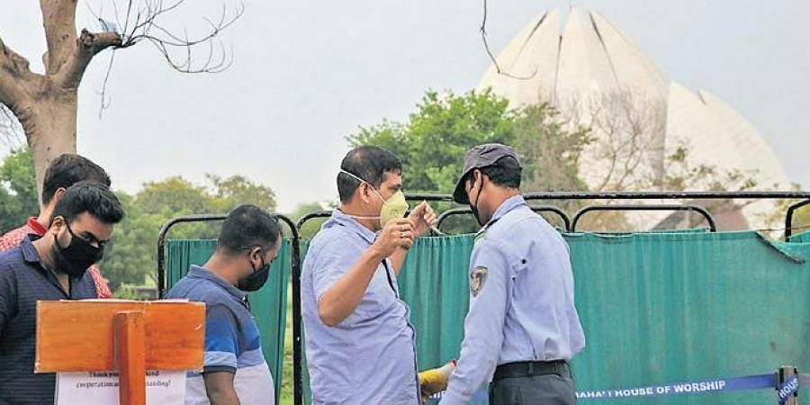 Visitors to the Lotus Temple being screened in New Delhi on Saturday.