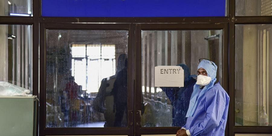 Coronavirus| A medic stands outside an isolation ward. (Photo| PTI)