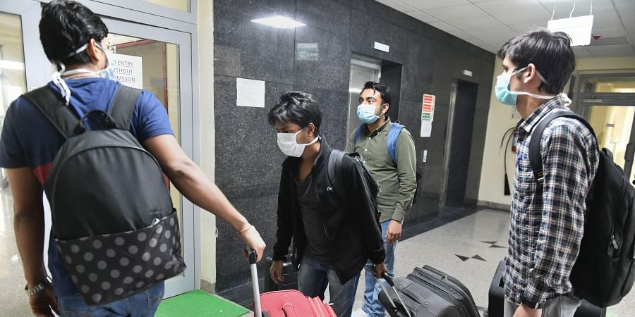 Evacuees leave after they were tested negative for the novel coronavirus COVID-19 at the ITBP facility in Chhawla Friday