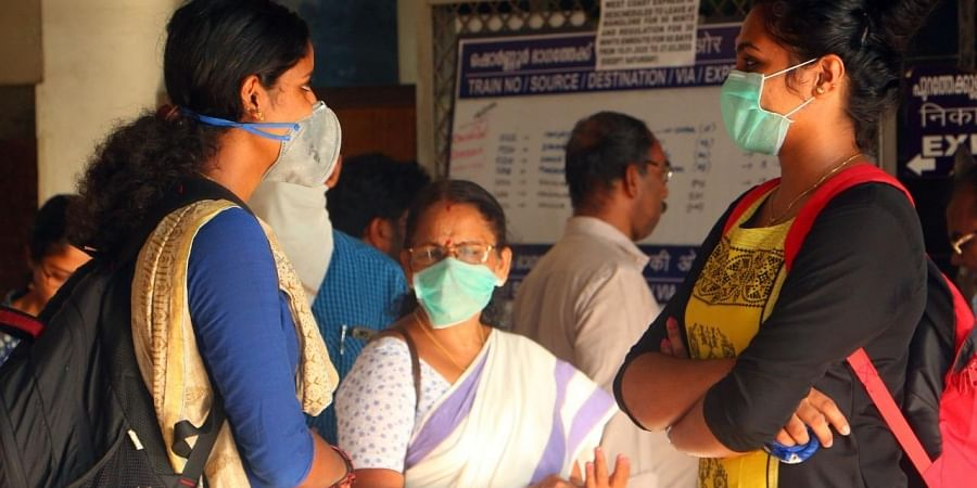 In the wake of coronavirus outbreak, people wear masks while travelling. (Photo| EPS/ TP Sooraj)