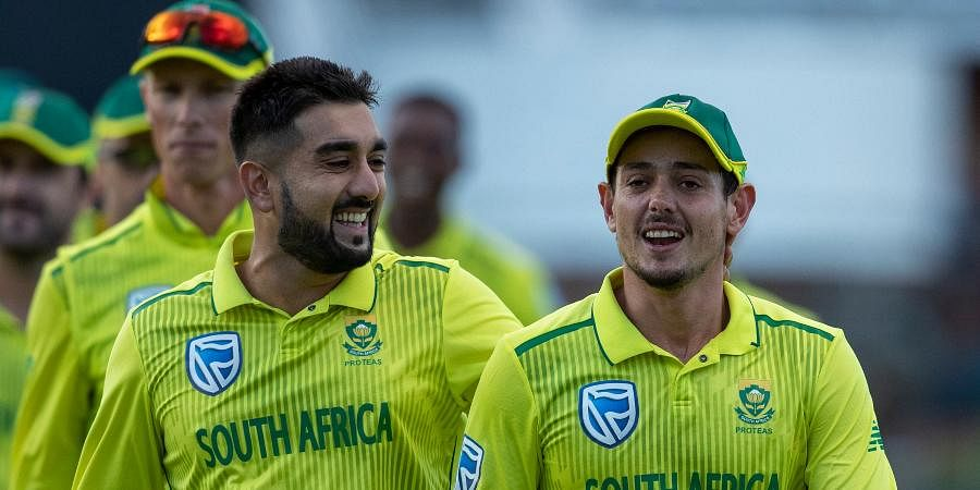 South Africa's bowler Tabraiz Shamsi, left, and captain Quinton de Kock leave the field at the end of the 2nd T20 cricket match between South Africa and Australia at St George's Park in Port Elizabeth.