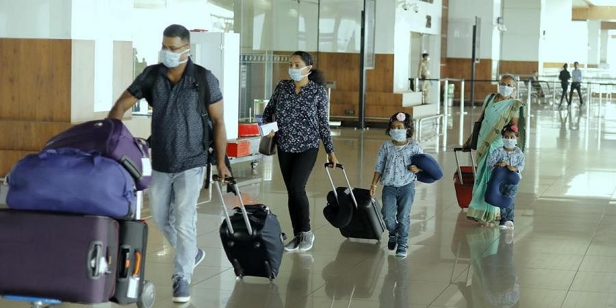 Corona, A family reaches Kochi airport wearing safety masks.