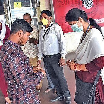 Railway employees wearing mask on duty at Bhubaneswar station on Monday. (Photo | Biswanath Swain, EPS)