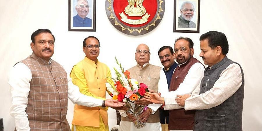 Ex-Madhya Pradesh CM Shivraj Singh Chouhan along with the leader of the opposition Gopal Bhargava and other party MLAs meets Governor Lalji Tandon at Raj Bhavan, in Bhopal