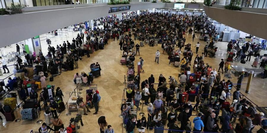 Passengers wait for their flight at the departure area of Manila's International Airport, Philippines on Tuesday