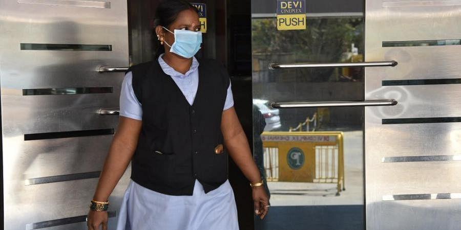 Woman wears mask in the wake of coronavirus pandemic. (Photo| EPS/ R.Satish babu)
