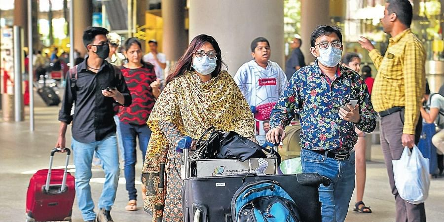 Passengers wearing protective masks as a precautionary measure against the coronavirus | Pti