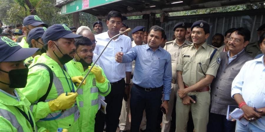 Transport Secretary Sanjay K Aggarwal meeting with drivers and seeing sanitization works in a bus